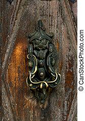 Old metal door handle knocker
