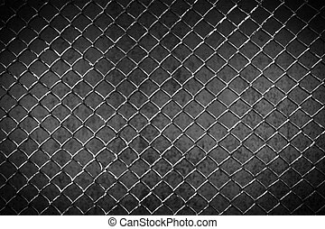 old metal fence on a dark background.