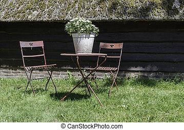 old metal furniture in garden