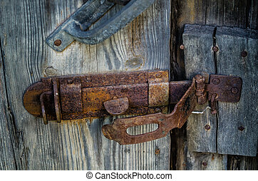 latch - old metal latch on wooden gate