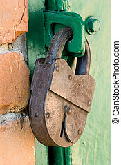 old metal lock on the wooden door