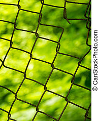 Old metal mesh on a blurred background