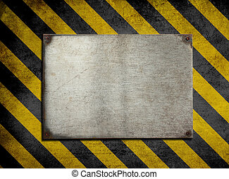 old metal plate background with hazard stripes