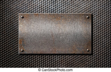 old metal rusty or rustic plate over comb grid background