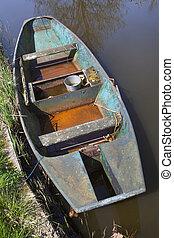 Old metal rusty rowing boat
