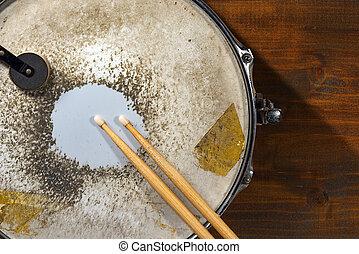 Old Metal Snare Drum with Drumsticks