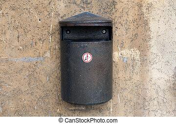 Old metal trash wall waste bin on the wall - Old metal trash...