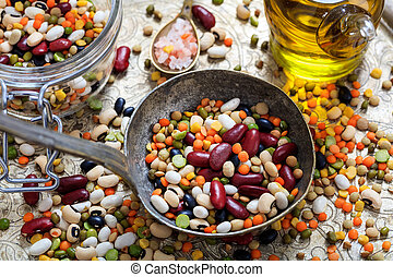 Old metallic spoon and mixed legumes - Old metallic spoon...