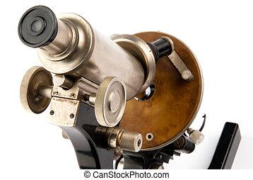 Old microscope closeup - closeup old microscope on white ...