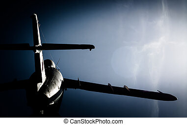 old military aircraft against the blue sky