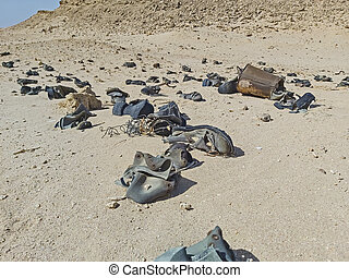 Old military army boots abandoned in remote african desert
