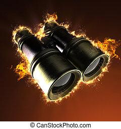 Old military binoculars in fire