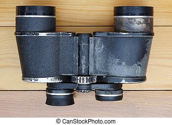 Old military binoculars on table