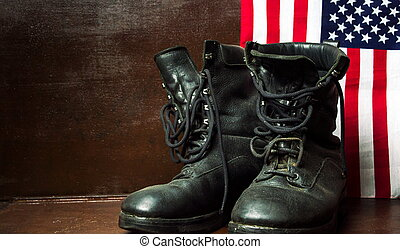 Old military boots and USA flag