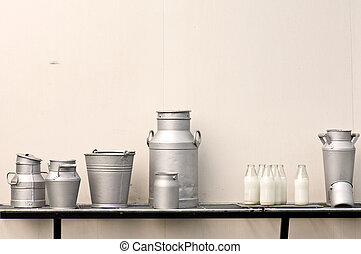 Old milk jugs, cans, bottles and bucket
