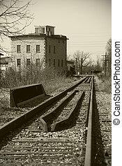Old Mill House Near Train Tracks
