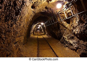 Old Mines - Mining tunnel with lights and rails