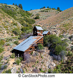 Old mining buildings at a gold mine site forgotten by time