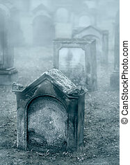 Mystery misty 19th century graveyard with a group of tombstones