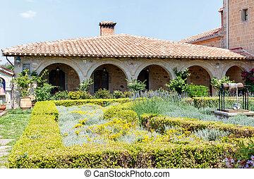 Old monastery garden full of flowers