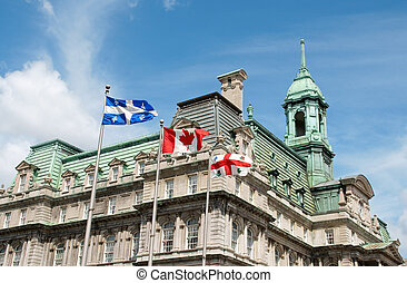 Old Montreal City Hall and flags of Quebec, Canada and the city