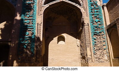 Old mosque carvings - A tilt up shot of old and ancient...