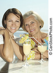 old mother and  daughter  with grapes
