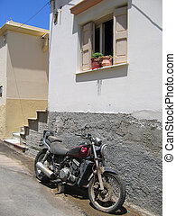 old motorcycle in front of the house