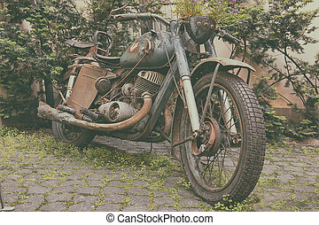 Old motorcycle in the courtyard of the house