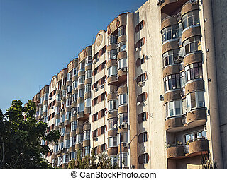 old multi-storey apartment building with balconies
