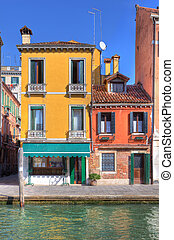 Old multicolored houses in Venice, Italy.