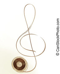 old music in sepia - reel with old music and tape in the...