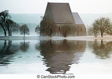 Old mysterious Church reflected in water