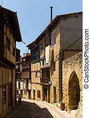 Old narrow street in Frias. Burgos, Spain