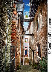 Old narrow street in small european town