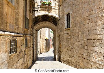 Old narrow street of medieval Girona