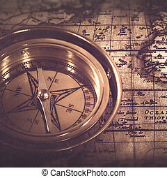 Old nautical compass over the map, abstract retro still life
