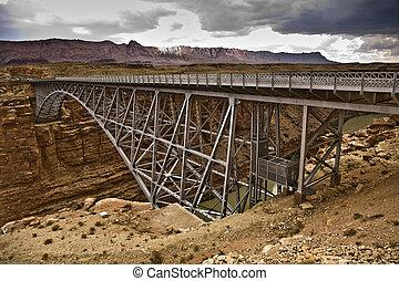 old Navajo Bridge spanning the Colorado at Marble Canyon -...