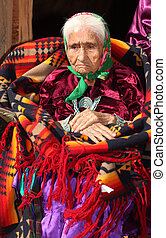 Old Navajo Woman Deep in Thought With Hands Crossed