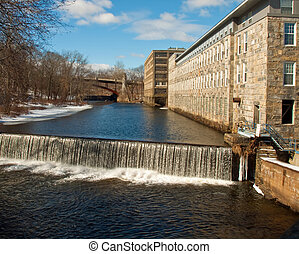 OLD NEW ENGLAND MILL - A old NEW ENGLAND mill next to a ...