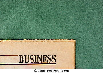 old newspaper on a green background