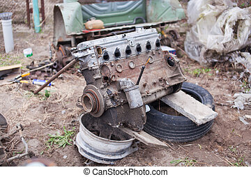 Old not working engine lies on the field
