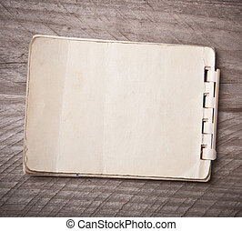 Old notebook on a wooden background