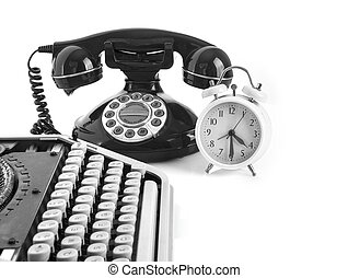 Old office Still life with retro typewriter, alarm clock, telephone on a white background with copy space