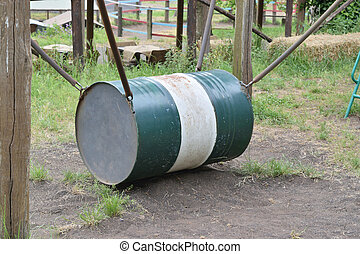 old oil barrel turned into the swing