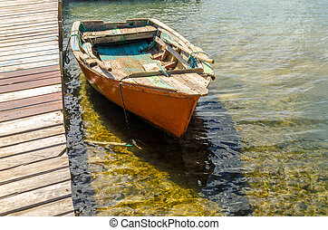 Old Orange Boat - Old orange boat by a pier in San Andres y...