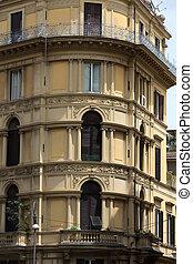 Old orange corner house in the center of Rome, Italy