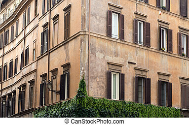 Old orange corner house in the center of Rome, Italy