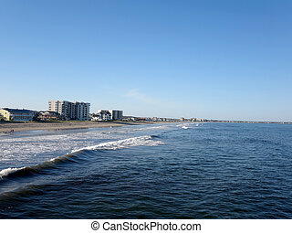 Old Orchard Beach, Maine - Waves lap on Old Orchard Beach ...