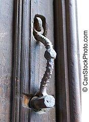 Old ornamental knocker hammer.